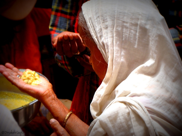 A widow getting her share at the food distribution